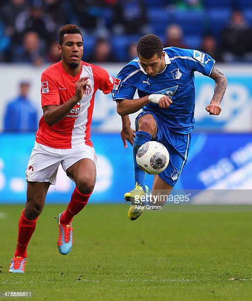 Fabian Johnson of Hoffenheim is challenged by EricMaxim ChoupoMoting of Mainz during the Bundesliga match between 1899 Hoffenheim and 1 FSV Mainz 05...