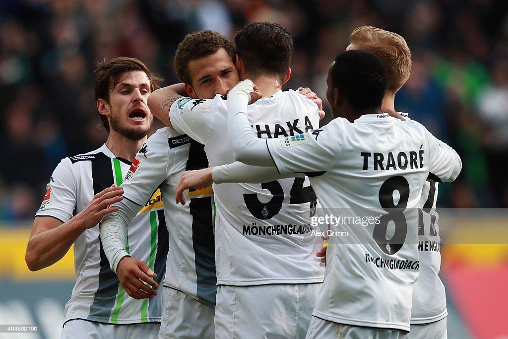 Fabian Johnson of Moenchengladbach celebrates his team's first goal with team mates during the Bundesliga match between Borussia Moenchengladbach and...