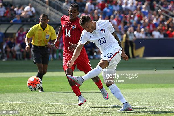 Fabian Johnson of the United States shoots in front of Miguel Camargo of Panama in the first half during the CONCACAF Gold Cup Third Place Match at...