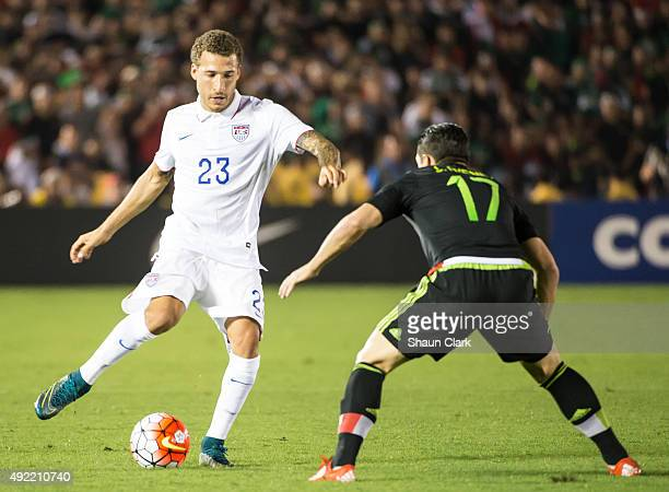 Fabian Johnson of the United States takes on Javier Guemez of Mexicoduring the CONCACAF Cup between the United States and Mexico at the Rose Bowl on...