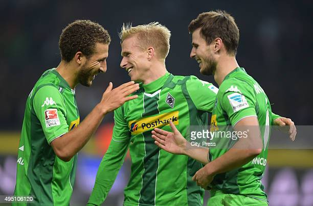 Fabian Johnson Oscar Wendt and Havard Nordtveit of Borussia Moenchengladbach celebrate after scoring the 14 during the game between Hertha BSC and...