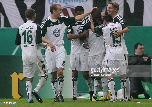 Fabian Johnson Thomas Kahlenberg Cicero Grafite Simon Kjaer and Karim Ziani of Wolfsburg celebrate the second goal during the DFB Cup first round...