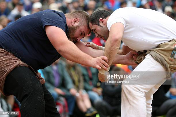 Fabian Kindlimann fights with Simon Jampen during the Alpine Wrestling Festival BruenigSchwinget at the top of the Bruenig Pass on July 27 2014 in...