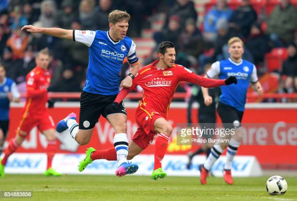 Fabian Klos of Arminia Bielefeld and Steven Skrzybski of 1 FC Union Berlin during the game between dem 1 FC Union Berlin and DSC Arminia Bielefeld on...