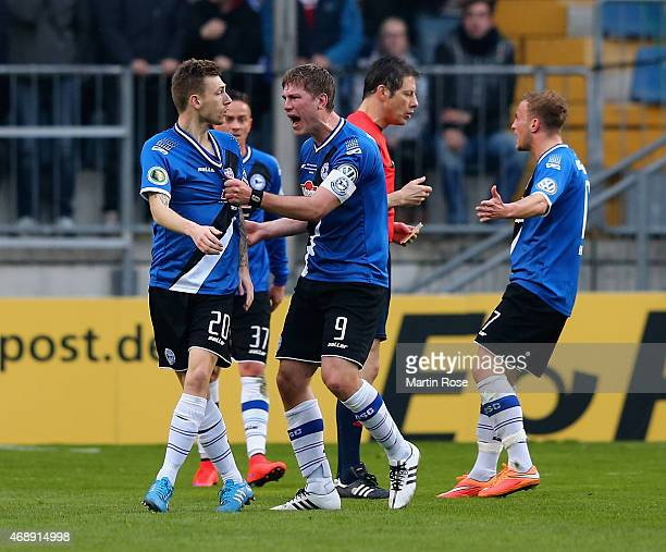 Fabian Klos of Arminia Bielefeld reacts towards team mate Manuel Junglas during the DFB Cup Quarter Final match between Arminia Bielefeld and...