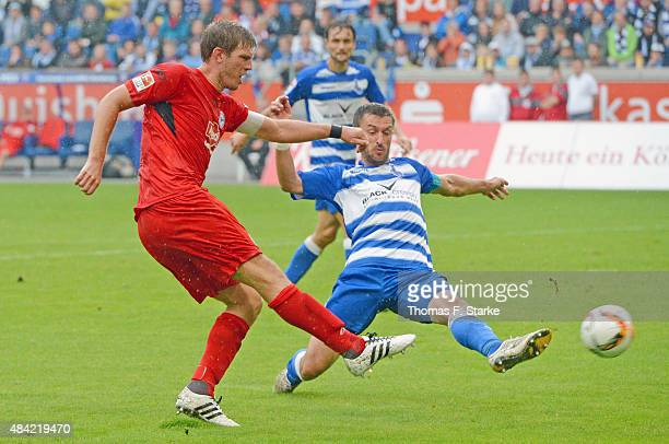 Fabian Klos of Bielefeld and Branimir Bajic of Duisburg fight for the ball during the Second Bundesliga match between MSV Duisburg and Arminia...