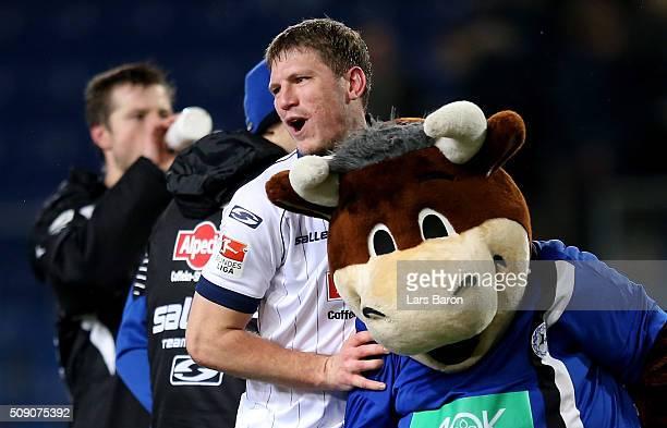 Fabian Klos of Bielefeld celebrates after winning the Second Bundesliga match between Arminia Bielefeld and MSV Duisburg at Schueco Arena on February...