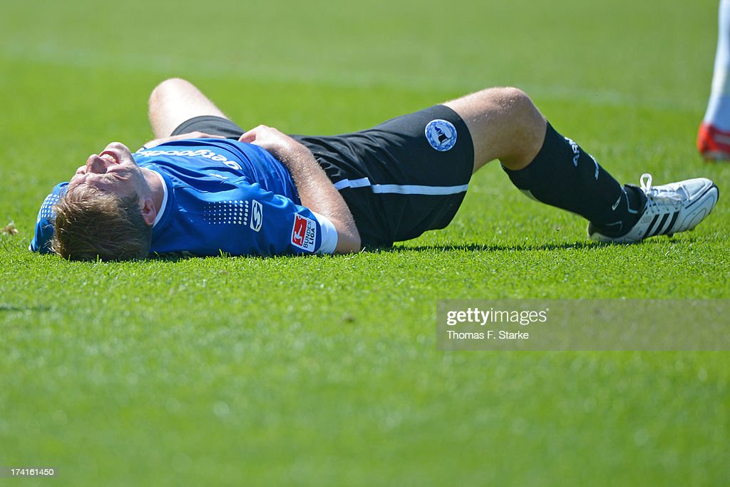 Fabian Klos of Bielefeld lays dejected on the pitch during the Second Bundesliga match between Greuther Fuerth and Arminia Bielefeld at the Trolli Arena on July 21, 2013 in Fuerth, Germany.