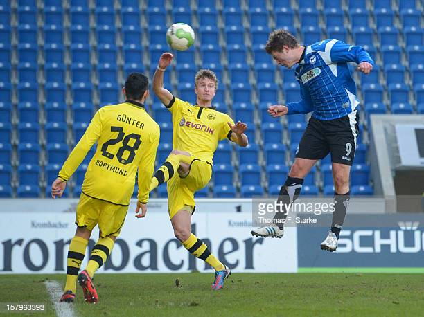 Fabian Klos of Bielefeld scores against Koray Guenter and Thomas Meissner of Dortmund during the Third League match between Arminia Bielefeld and...