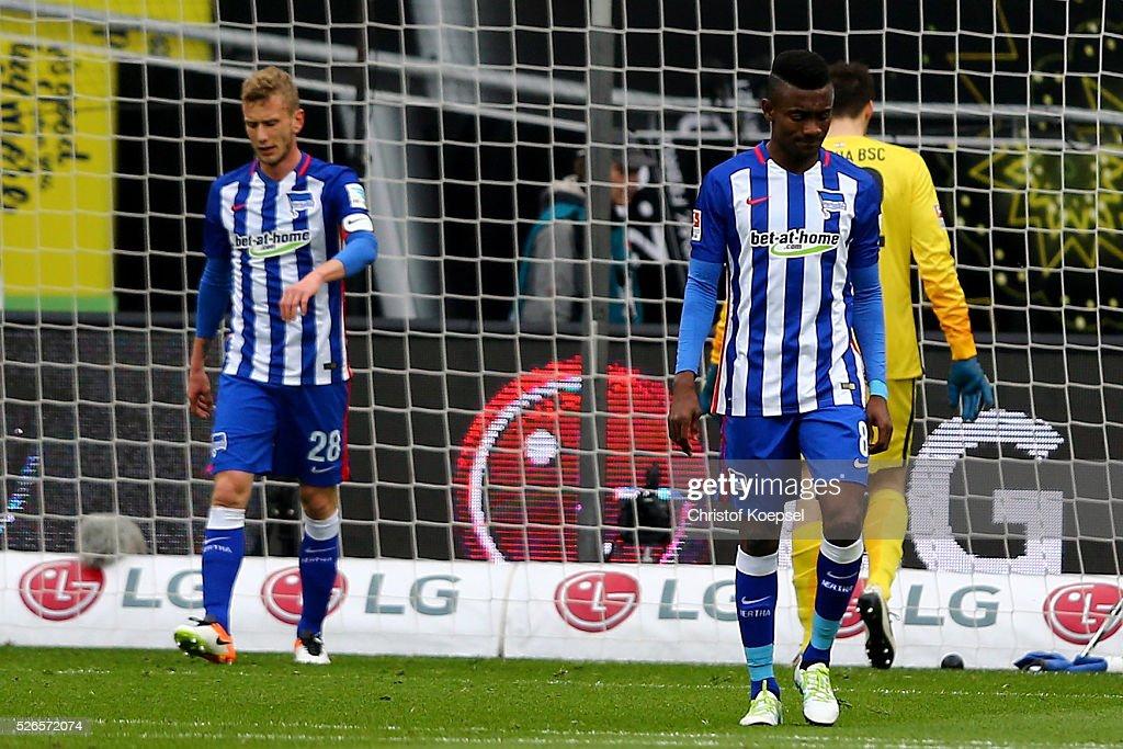 Fabian Lustenberger and Salomon Kalou of Berlin look dejected after the second goal of Leverkusen during the Bundesliga match between Bayer Leverkusen and Hertha BSC Berlin at BayArena on April 30, 2016 in Leverkusen, Germany.