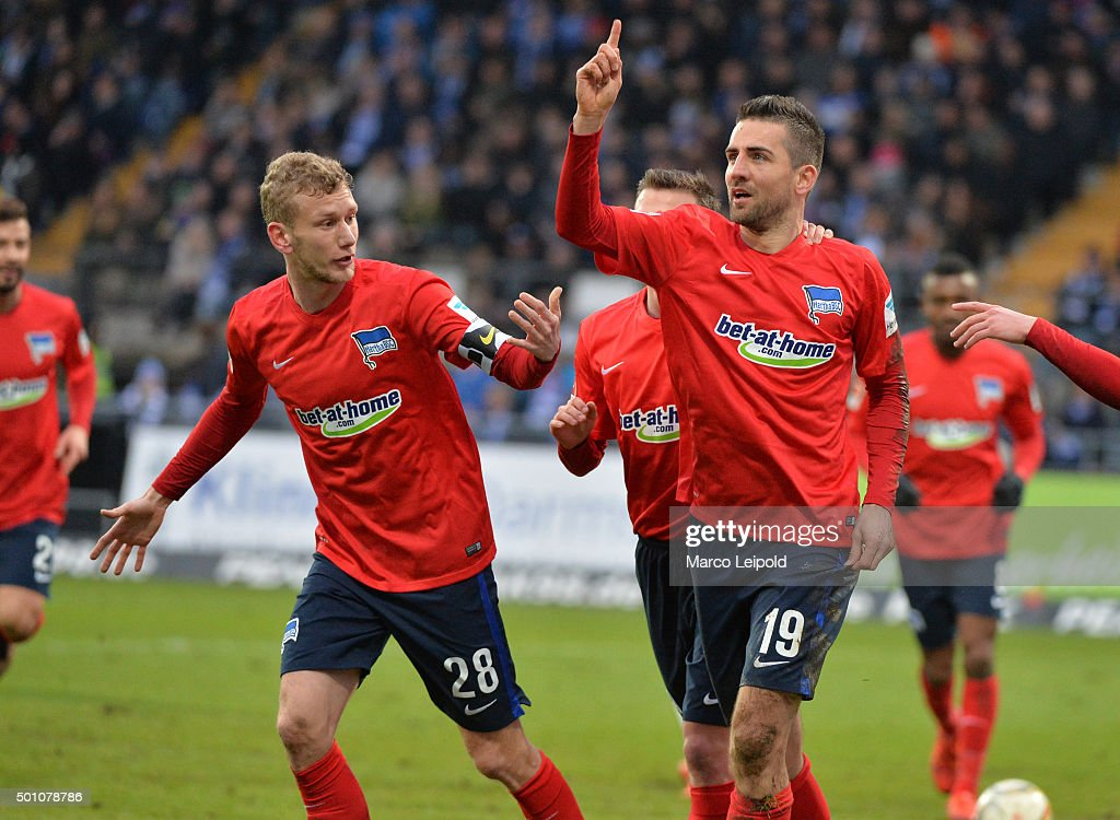 Fabian Lustenberger and Vedad Ibisevic of Hertha BSC celebrate after scoring the 0:1 during the Bundesliga match between SV Darmstadt 98 and Hertha BSC on December 12, 2015 in Darmstadt, Germany.
