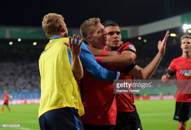 Fabian Lustenberger Mitchell Weiser and Karim Rekik of Hertha BSC celebrate after scoring the 01 during the game between FC Hansa Rostock and Hertha...