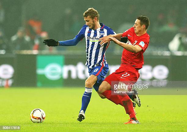 Fabian Lustenberger of Berlin battles for the ball with Dominik Kohr of Augsburg during the Bundesliga match between Hertha BSC and FC Augsburg at...