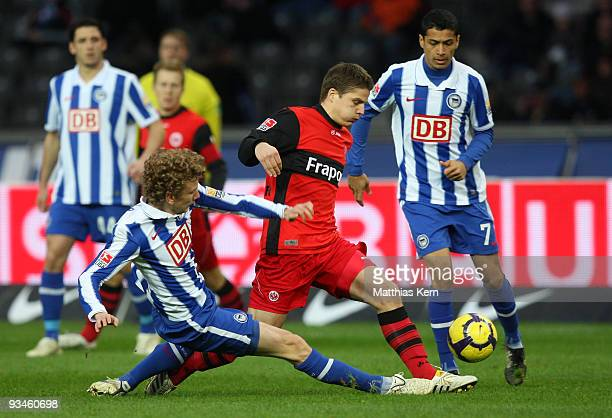 Fabian Lustenberger of Berlin battles for the ball with Pirmin Schwegler of Frankfurt during the Bundesliga match between Hertha BSC Berlin and...