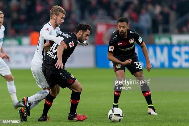 Fabian Lustenberger of Berlin Hakan Calhanoglu of Leverkusen and Karim Bellarabi of Leverkusen during the Bundesliga match between Bayer 04...
