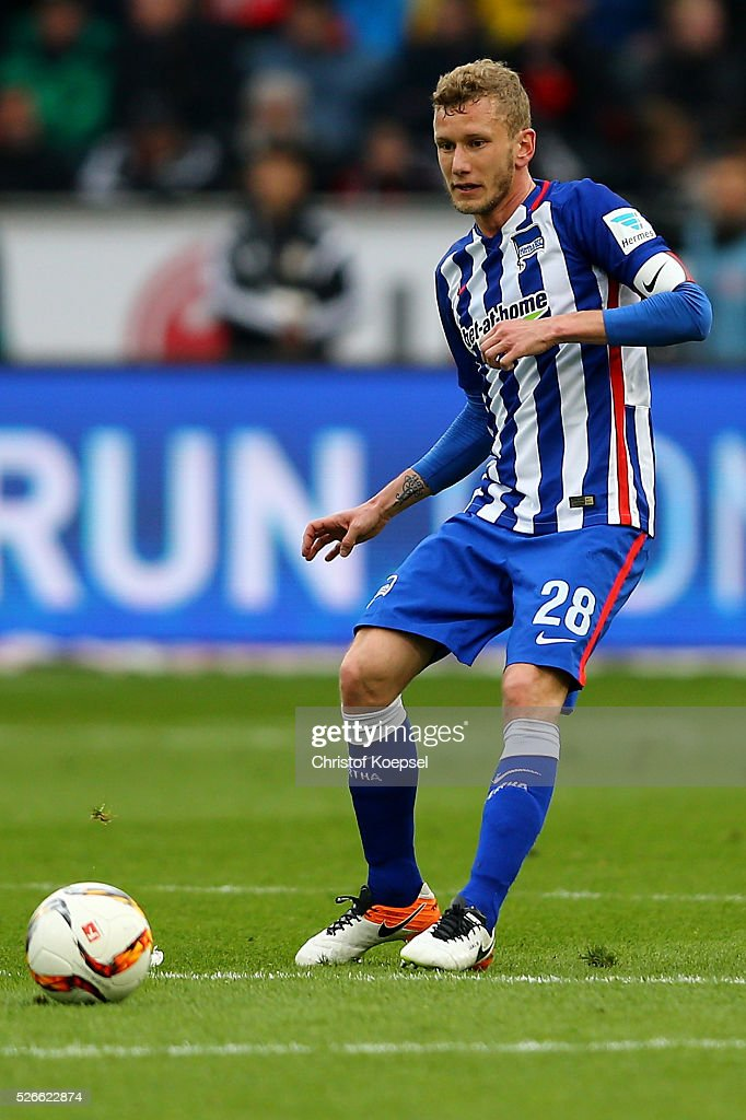 Fabian Lustenberger of Berlin runs with the ball during the Bundesliga match between Bayer Leverkusen and Hertha BSC Berlin at BayArena on April 30, 2016 in Leverkusen, Germany.