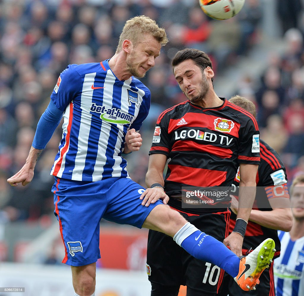 Fabian Lustenberger of Hertha BSC and Hakan Calhanoglu of Bayer 04 Leverkusen during the game between Bayer 04 Leverkusen and Hertha BSC on april 30, 2016 in Leverkusen, Germany.