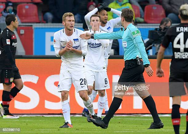 Fabian Lustenberger of Hertha BSC and referee Tobias Stieler the auf Elfmeter entscheidet during the game between Bayer 04 Leverkusen and Hertha BSC...