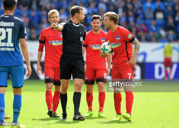 Fabian Lustenberger referee Markus Schmidt Mathew Leckie and Alexander Esswein of Hertha BSC during the game between TSG Hoffenheim and Hertha BSC on...