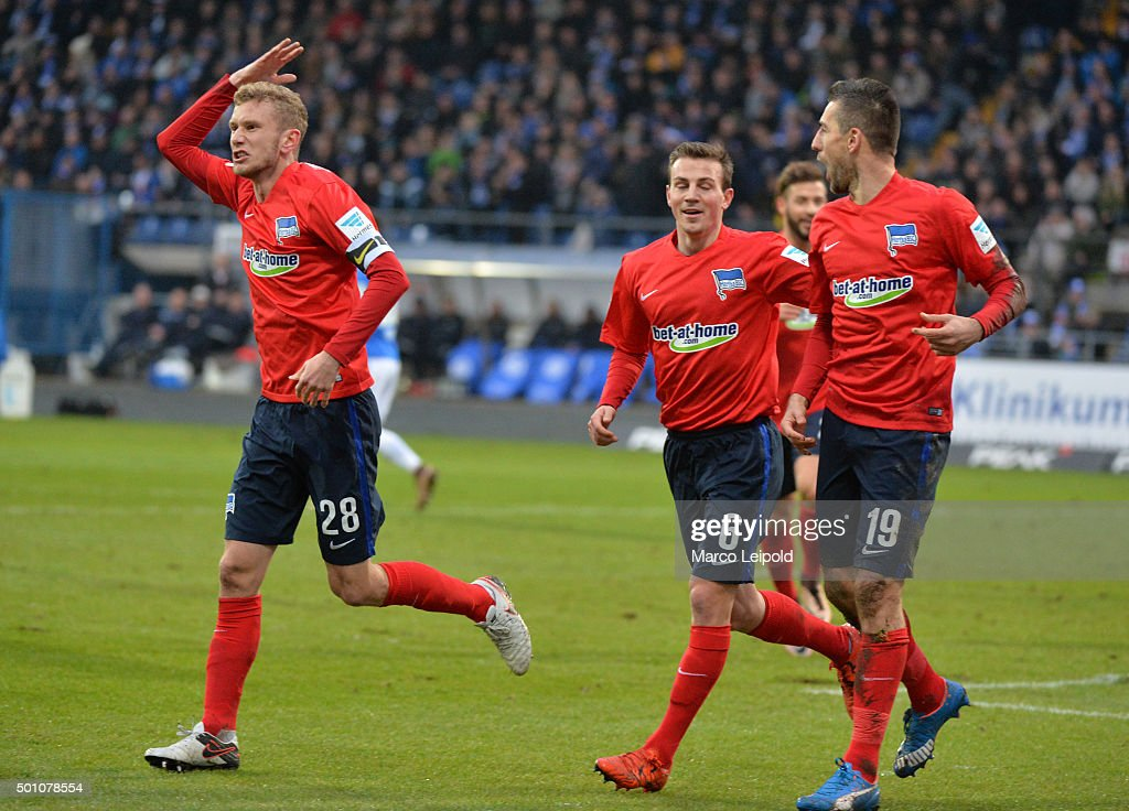Fabian Lustenberger, Vladimir Darida and Vedad Ibisevic of Hertha BSC celebrate after scoring the 0:1 during the Bundesliga match between SV Darmstadt 98 and Hertha BSC on December 12, 2015 in Darmstadt, Germany.