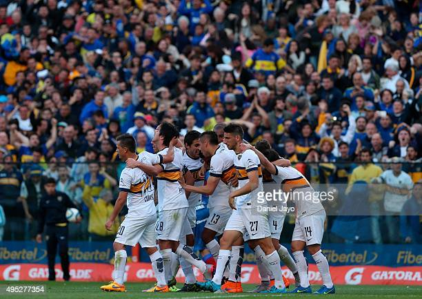 Fabian Monzon of Boca Juniors celebrates with teammates after scoring the opening goal during a match between Boca Juniors and Tigre as part of 29th...