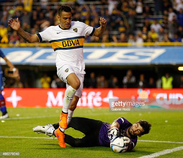 Fabian Monzon of Boca Juniors fights for the ball with Javier Garcia of Tigre during a match between Boca Juniors and Tigre as part of 29th round of...