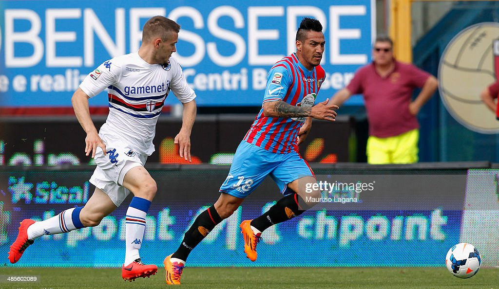 Fabian Monzon (R) of Catania competes for the ball with <a gi-track='captionPersonalityLinkClicked' href=/galleries/search?phrase=Shkodran+Mustafi&family=editorial&specificpeople=5006425 ng-click='$event.stopPropagation()'>Shkodran Mustafi</a> of Sampdoria during the Serie A match between Calcio Catania and UC Sampdoria at Stadio Angelo Massimino on April 19, 2014 in Catania, Italy.