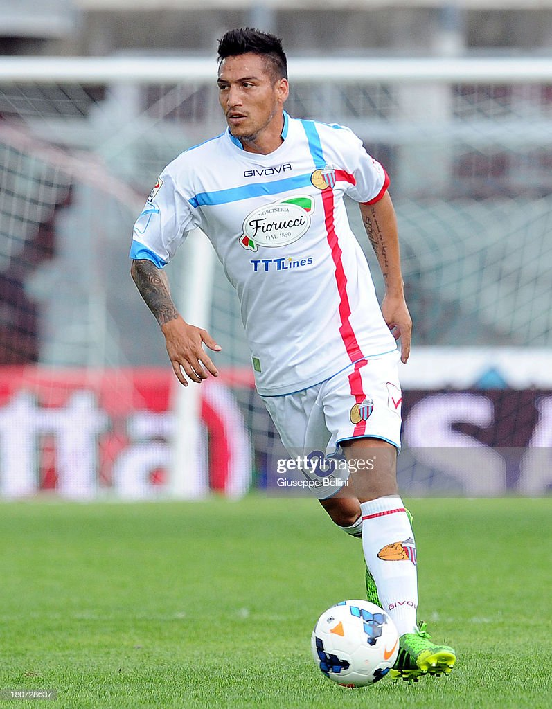Fabian Monzon of Catania in action during the Serie A match between AS Livorno Calcio and Calcio Catania at Stadio Armando Picchi on September 15, 2013 in Livorno, Italy.