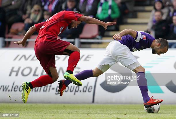 Fabian Mueller of Aue challenges Elias Kachunga of Paderborn during the 2nd Liga match between FC Erzgebirge Aue and SC Paderborn 07 at...