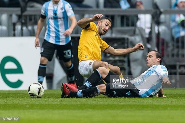 Fabian Mueller of Dynamo Dresden and Michael Liendl of TSV 1860 Muenchen battle for the ball during the Second Bandesliga match between TSV 1860...