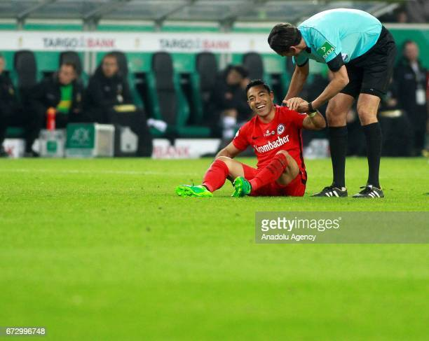 Fabian of Eintracht Frankfurt and Referee Deniz Aytekin chat during the DFB Cup semifinal soccer match between Borussia Monchengladbach and Eintracht...