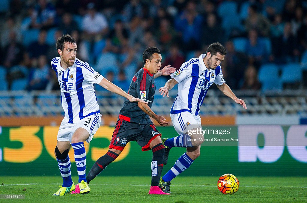 Fabian Orellana of Celta de Vigo duels for the ball with Joseba Zaldua and Mikel Gonzalez of Real Sociedad during the La Liga match between Real...