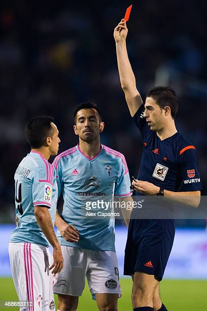 Fabian Orellana of Celta Vigo is shown a red card by referee Inaki Vicandi Garrido during the La Liga match between Celta Vigo and FC Barcelona at...
