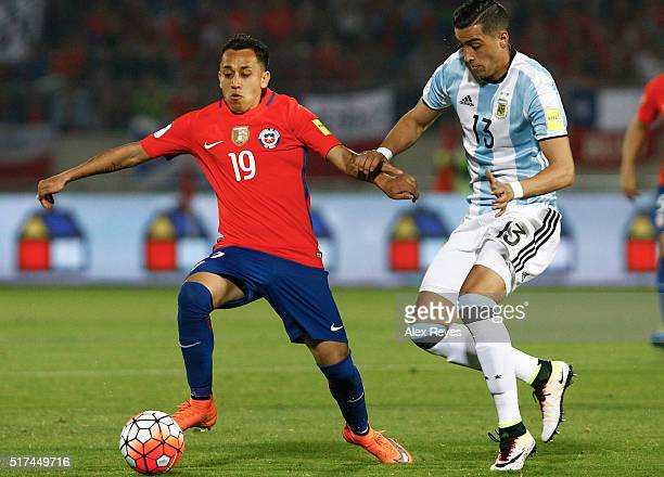 Fabian Orellana of Chile fights for the ball with Ramiro Funes Mori of Argentina during a match between Chile and Argentina as part of FIFA 2018...
