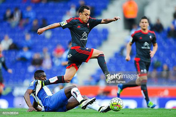 Fabian Orellana of RC Celta de Vigo competes for the ball with Pape Diop of RCD Espanyol during the La Liga match between Real CD Espanyol and Celta...