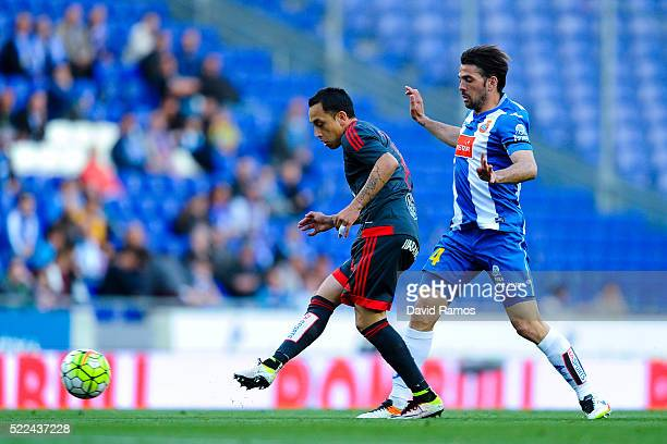 Fabian Orellana of RC Celta de Vigo competes for the ball with Victor Sanchez of RCD Espanyol during the La Liga match between Real CD Espanyol and...
