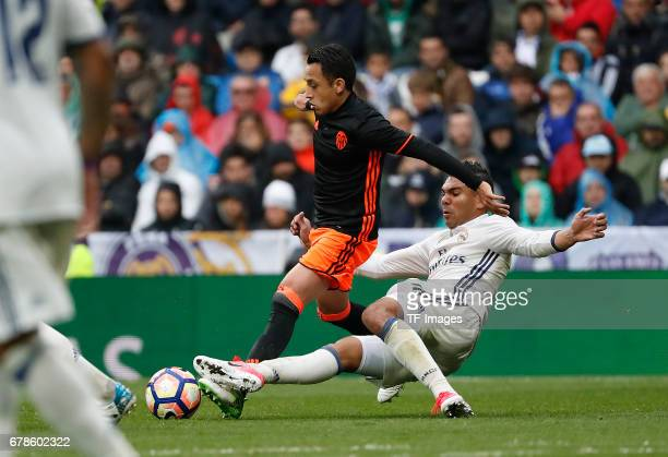 Fabian Orellana of Valencia and Carlos Enrique Casemiro of Real Madrid battle for the ball during the La Liga match between Real Madrid CF and...