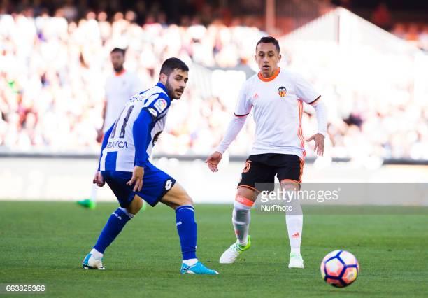 Fabian Orellana of Valencia CF and Carles Gil of Deportivo de la Corua during their La Liga match between Valencia CF and Deportivo de la Corua at...
