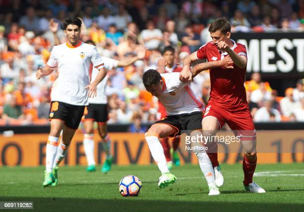 Fabian Orellana of Valencia CF and Clement Lenglet of Sevilla FC during their La Liga match between Valencia CF and Sevilla FC at the Mestalla...