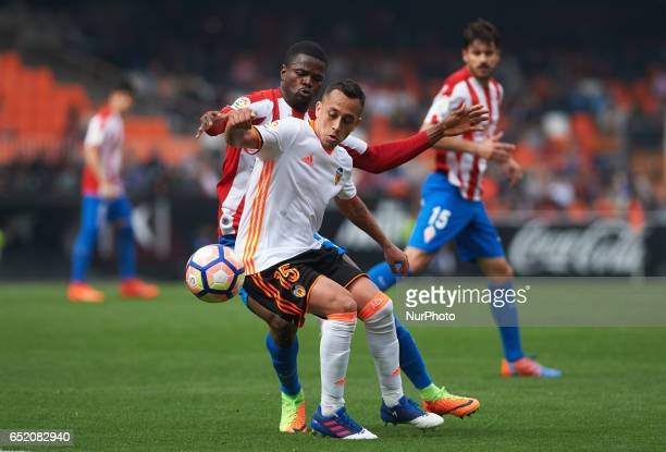 Fabian Orellana of Valencia CF and Elderson Echiejile of Real Sporting de Gijon during their La Liga match between Valencia CF and Real Sporting de...