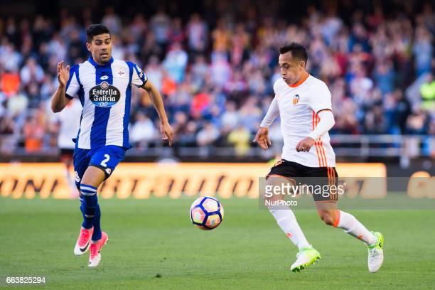 Fabian Orellana of Valencia CF and Juanfran Moreno of Deportivo de la Corua during their La Liga match between Valencia CF and Deportivo de la Corua...