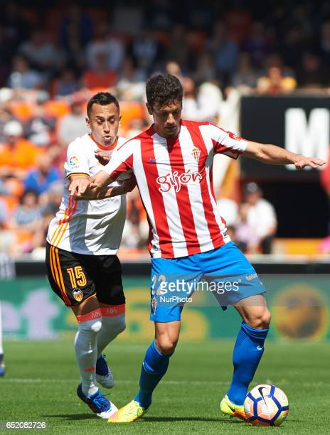Fabian Orellana of Valencia CF and Mikel Vesga of Real Sporting de Gijon during their La Liga match between Valencia CF and Real Sporting de Gijon at...