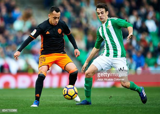 Fabian Orellana of Valencia CF being followed by Ruben Pardo of Real Betis Balompie during La Liga match between Real Betis Balompie and Valencia CF...