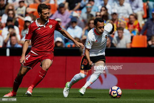 Fabian Orellana of Valencia CF competes for the ball with Vazquez of Sevilla FC during the La Liga match between Valencia CF and Sevilla FC at...