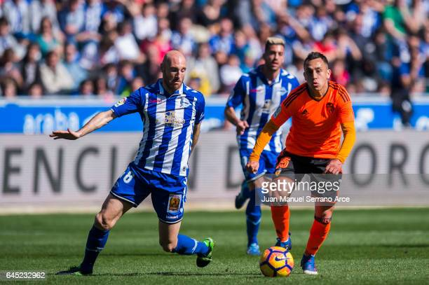 Fabian Orellana of Valencia CF duels for the ball with Gaizka Toquero of Deportivo Alaves during the La Liga match between Deportivo Alaves and...