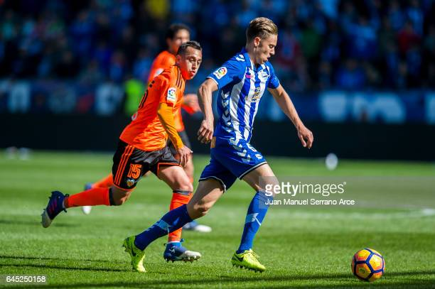 Fabian Orellana of Valencia CF duels for the ball with Marcos Llorente of Deportivo Alaves during the La Liga match between Deportivo Alaves and...