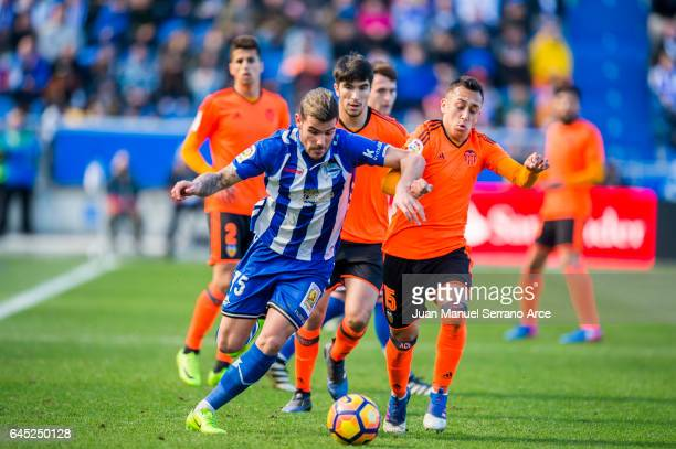 Fabian Orellana of Valencia CF duels for the ball with Theo Hernandez of Deportivo Alaves during the La Liga match between Deportivo Alaves and...