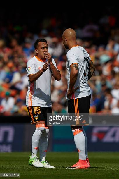 Fabian Orellana of Valencia CF talks with his teammate Simone Zaza during the La Liga match between Valencia CF and Sevilla FC at Mestalla stadium on...