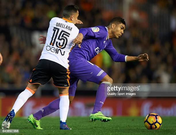 Fabian Orellana of Valencia competes for the ball with Casemiro of Real Madrid during the La Liga match between Valencia CF and Real Madrid at...