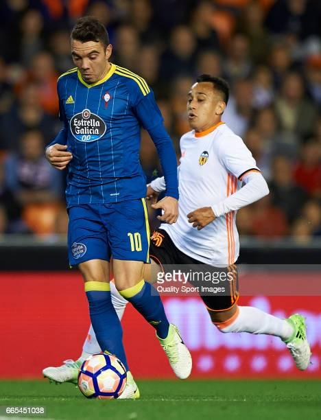 Fabian Orellana of Valencia competes for the ball with Iago Aspas of Celta de Vigo during the La Liga match between Valencia CF and RC Celta de Vigo...
